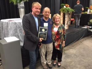 Renee Meritorious Service Award Winner René Van Rems AIFD, PFCI with CSFA President Wilton Lee CCF and CSFA EVP Ann Quinn